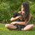 Teenage girl with puppy on lawn stock photo © JFJacobsz