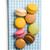 colorful macaroons on checkered napkin stock photo © jirkaejc