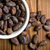 cocoa beans in bowl on wooden table stock photo © jirkaejc