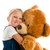 little girl with big teddy bear stock photo © jirkaejc