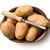 wooden peeler and potatoes stock photo © jirkaejc