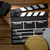 clapper board with movie light and film reels on wooden table stock photo © jirkaejc