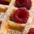 fresh waffles garnished with powdered sugar and raspberries  stock photo © joannawnuk