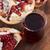 ripe pomegranates with juice on table stock photo © joannawnuk