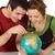 Couple looking at globe stock photo © joseph73