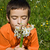 boy smelling flowers stock photo © joseph73
