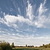 meadow and clouds skyscape stock photo © juhku