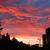 amazing red sunset and buildings stock photo © juhku