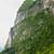 big limestone cliff and bamboo boat stock photo © juhku