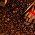 coffee beans with cinnamon and wooden ladle stock photo © kalozzolak
