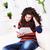 sério · menina · leitura · sofá · casa · mulher - foto stock © kalozzolak
