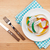 plate with measure tape knife and fork diet food on wooden tab stock photo © karandaev