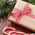 christmas gift box candy cane and tree branch stock photo © karandaev