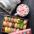 colorful macaroons in a gift box and headphones stock photo © karandaev