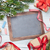 christmas chalkboard gifts decor and fir tree stock photo © karandaev