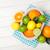cítrico · frutas · cesta · laranjas · limões · mesa · de · madeira - foto stock © karandaev