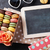 colorful macaroons and blackboard stock photo © karandaev