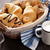 fresh croissants basket and milk stock photo © karandaev