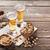 cerveja · óculos · lanches · mesa · de · madeira · nozes - foto stock © karandaev