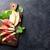 vers · meloen · prosciutto · basilicum · antipasti · houten · tafel - stockfoto © karandaev