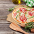 pizza · prosciutto · mozzarella · mesa · de · madera · superior · vista - foto stock © karandaev