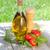 olive oil bottle pepper shaker basil and ripe tomatoes stock photo © karandaev
