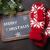 christmas fir tree mittens and chalkboard stock photo © karandaev