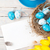 easter background with blue and white eggs in nest yellow tulip stock photo © karandaev