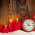 christmas background with candles and clock stock photo © karandaev