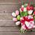 easter eggs and colorful tulips stock photo © karandaev