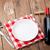 asztal · üres · tányér · borospohár · vörösbor · üveg - stock fotó © karandaev