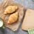 vers · croissants · melk · stuk · papier · houten · tafel - stockfoto © karandaev