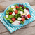 fresh healthy salad with tomatoes and mozzarella on wooden table stock photo © karandaev
