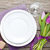 purple tulip bouquet and plate on wooden table stock photo © karandaev