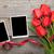 fresh tulips and blank photo frames stock photo © karandaev