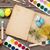 colorful easter eggs book and paint brushes stock photo © karandaev