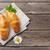 croissants · camomila · flores · mesa · de · madeira · topo · ver - foto stock © karandaev