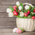 colorful tulips bouquet basket and easter eggs stock photo © karandaev
