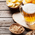 bier · snacks · houten · tafel · noten · chips - stockfoto © karandaev