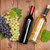 red and white wine bottles and bunch of grapes stock photo © karandaev