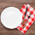 empty plate and silverware over wooden table stock photo © karandaev