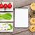 tomatoes mozzarella pasta and green salad leaves with notepad stock photo © karandaev