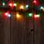 christmas tree branch and colorful lights stock photo © karandaev
