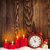 christmas background with candles alarm clock and snowman stock photo © karandaev