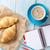 fresh croissants coffee and notepad stock photo © karandaev