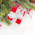 christmas fir tree branch with holly berry and gift box stock photo © karandaev