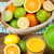 citrus fruits and glass of juice oranges limes and lemons stock photo © karandaev