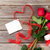 red roses gift box and heart shape ribbon over wood stock photo © karandaev