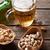 világos · sör · sör · harapnivalók · fa · asztal · különböző · diók - stock fotó © karandaev