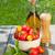 fresh ripe tomatoes olive oil bottle pepper shaker and herbs stock photo © karandaev